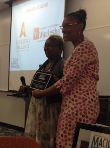 Manadra Rainey of Milwaukee Center for Independence accepts the award for Outstanding Employer Internship Program from Mary Spencer of Milwaukee School of Engineering